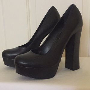 Black pumps with thick sturdy 5 1/2 heel.